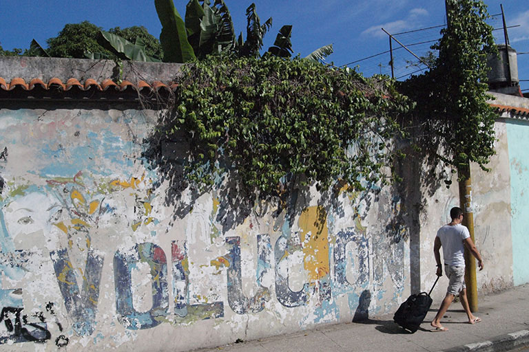 Faded revolutionary wall painting in Havana 2014